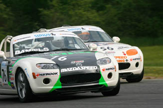 Jim Daniels (front) barely leads Todd Buras during Monday's MX-5 Cup race at Lime Rock Park.